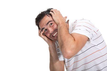 hombre asustado: Retrato de un hombre asustado con las manos en la cabeza Foto de archivo