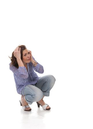 Scared woman holding her head   Stock Photo - 5052556