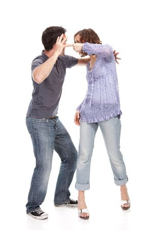 Angry couple yelling at each other  isolated over white background photo