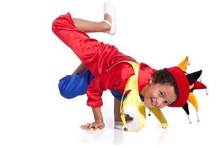 Breakdancing boy dressed in clown costume break a dance
