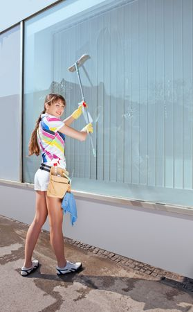 window washer: Young woman washing the window