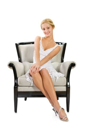 young woman sitting on chair against isolated white background   photo