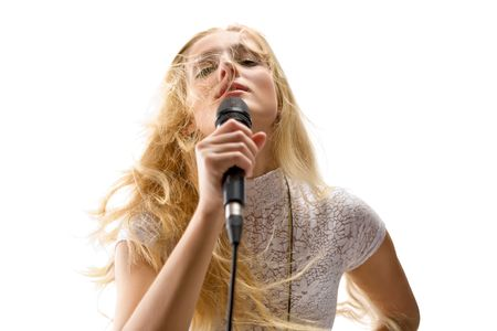 performace: beautiful blond young woman singing into a  microphone,  isolated on white background