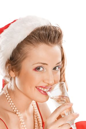 Attractive girl in Santa  hat with champagne glass, isolated on white  photo