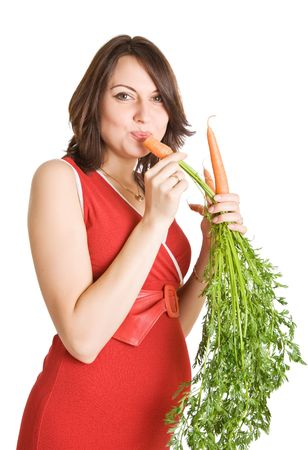 pregnant woman with fresh carrots, isolated on white