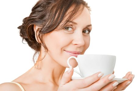 young woman enjoying a cup of tea photo