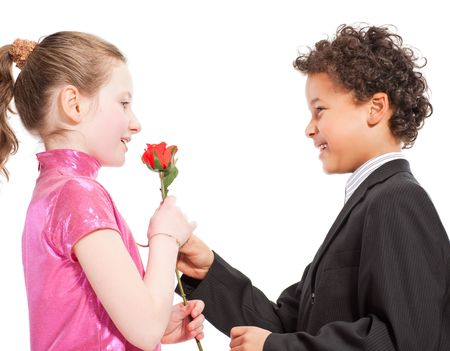 boy giving a rose to a girl, isolated on a white background photo
