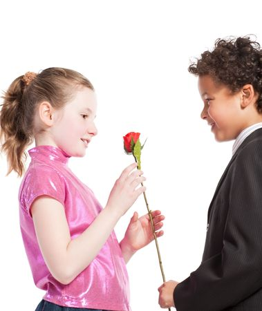 boy giving a rose to a girl, isolated on a white background Stock Photo - 6223921