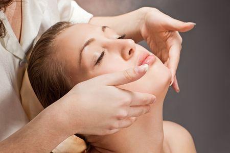 A beautiful young woman getting a massage photo