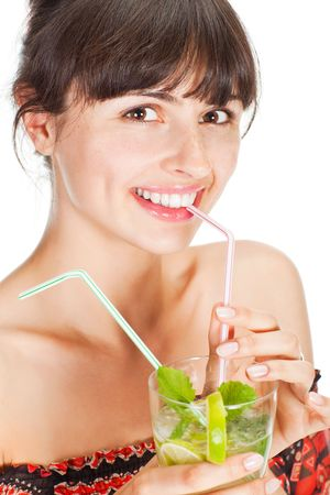 Young sexy woman with a cocktail, isolated on white photo