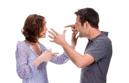 Angry couple yelling at each other  isolated over white background Stock Photo