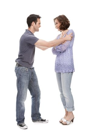 Angry couple yelling at each other  isolated over white background Stock Photo - 10814263