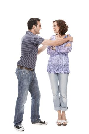 argument from love: Angry couple yelling at each other  isolated over white background Stock Photo