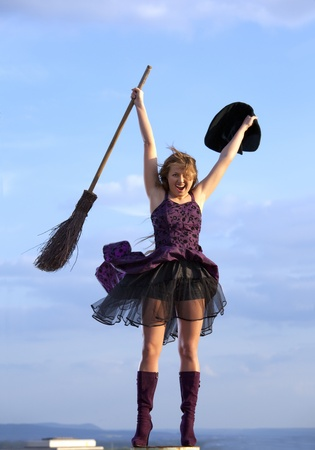 brooms: pretty witch with hat and broom Stock Photo