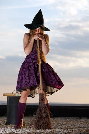 pretty witch with hat and broom Stock Photo - 10190230