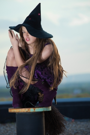 pretty witch with hat and broom Stock Photo - 10190070