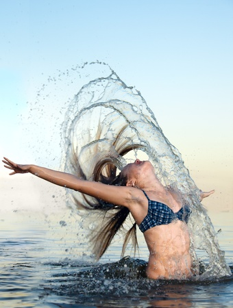 blonde woman on water bckground photo