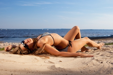 hot girl lying: girl lying on a beach Stock Photo