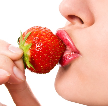 Closeup of a young girl mouth with a strawberry Stock Photo