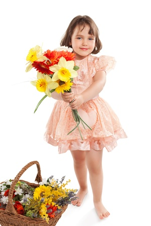 little girl smiling: Cute little girl with flowers Stock Photo