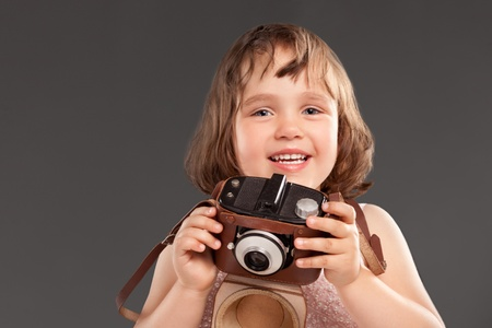 little girl with a old camera photo