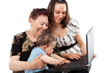grandma and Mother with baby with laptop photo