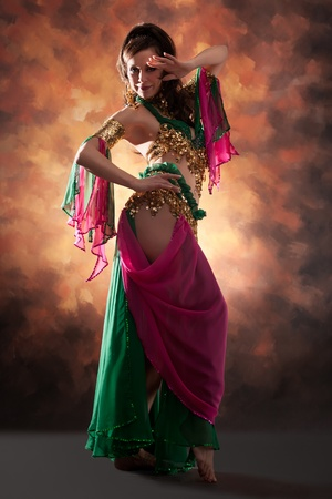 belly dancing: Beautiful exotic belly dancer woman