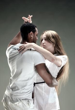 Young couple dances Salsa. Vintage photo. photo