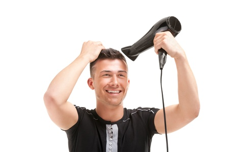 Portrait of a handsome young man with hairdryer photo