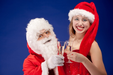 Santa Claus with sexy girl in Santa hat  photo