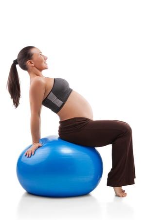 Pregnant woman doing exercises Stock Photo - 12871757