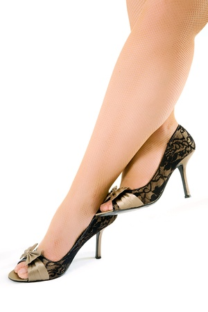 stifle: sexy woman legs in black shoes isolated on white background