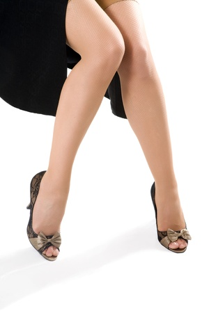 jackboots: sexy woman legs in black shoes isolated on white background