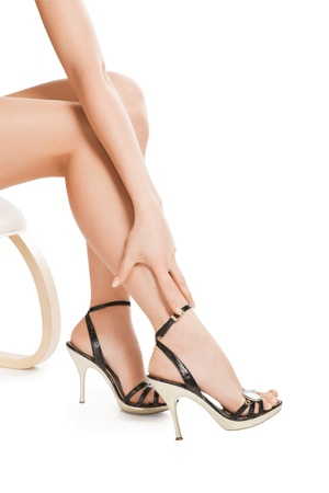 foot fetish: Beautiful legs in black shoes isolated on white background