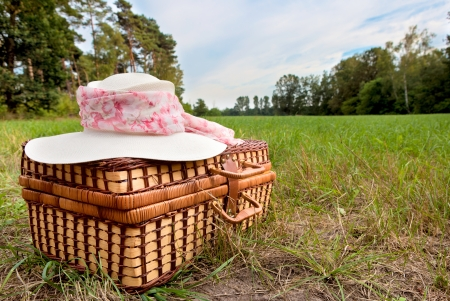 picnic basket with straw hat photo