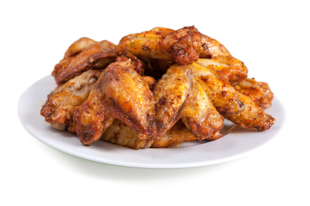 hot wings: Plate of delicious barbecue chicken wings, on white