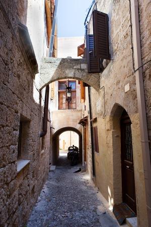 Typical narrow lane in Lindos, Rhodes, Greece photo