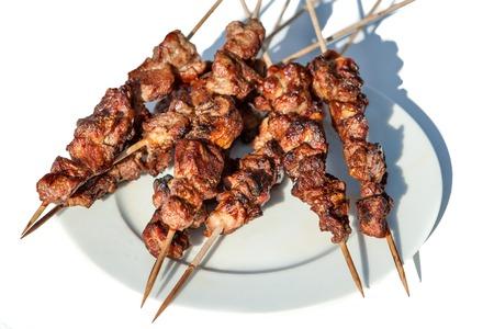 shashlik: Grilled kebab shashlik on spits Stock Photo