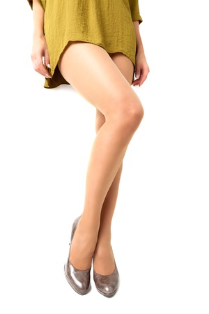 Long pretty woman legs on white background photo