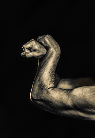 Close-up of a mans arm. Strong and power man's hand. Low key shoot. Banque d'images