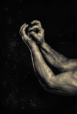 Close-up of a mans arm. Strong and power man's hand. Low key shoot. 写真素材