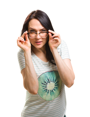 Woman with her glasses lifted up cant see