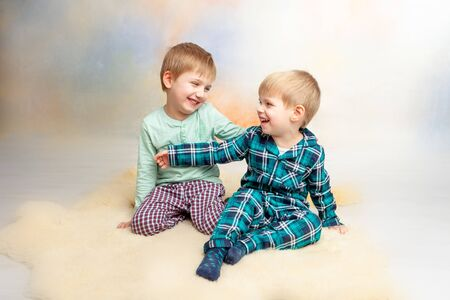 children play on the floor. in pajamas in the morning after sleep. Stock Photo - 136801194