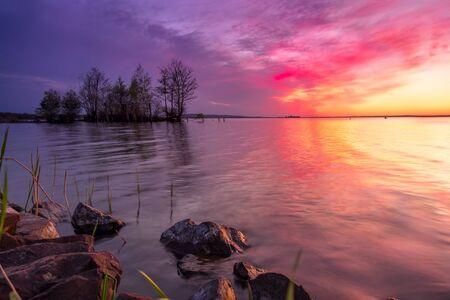 Beautiful romantic colorful sunset over a calm lake