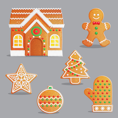 Traditional Catholic Christmas gingerbread treats with icing and sweet candy decorations, house, festive tree, celebration bauble ornament and other.