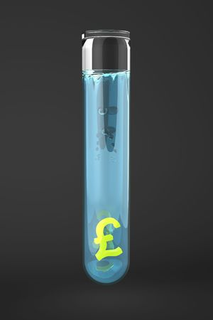 yellow Pound sign in Test tube filled with blue water on black backdrop photo