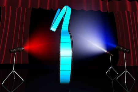 Blue film reel on black background lit by multy coloured lights