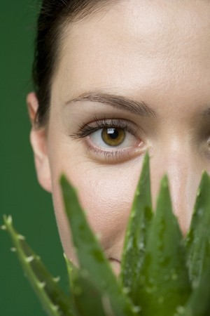 alternative living: Close up woman and aloe plant