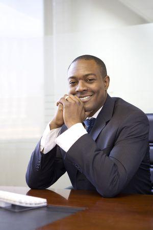 Portrait of businessman sitting at desk Stock Photo - 4445701