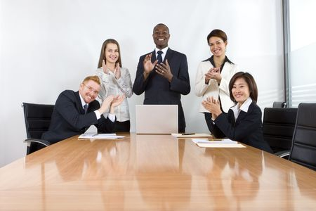 applause: Co-workers in business meeting Stock Photo